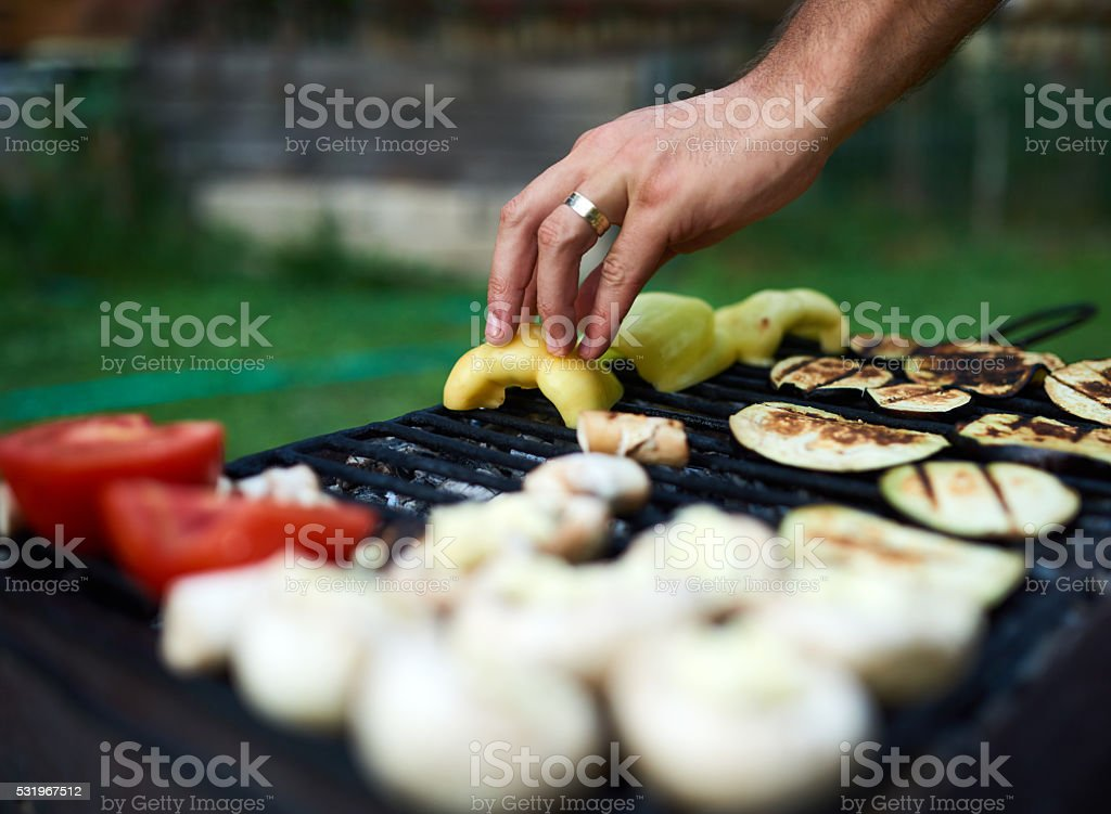 preparing vegetables on grill stock photo