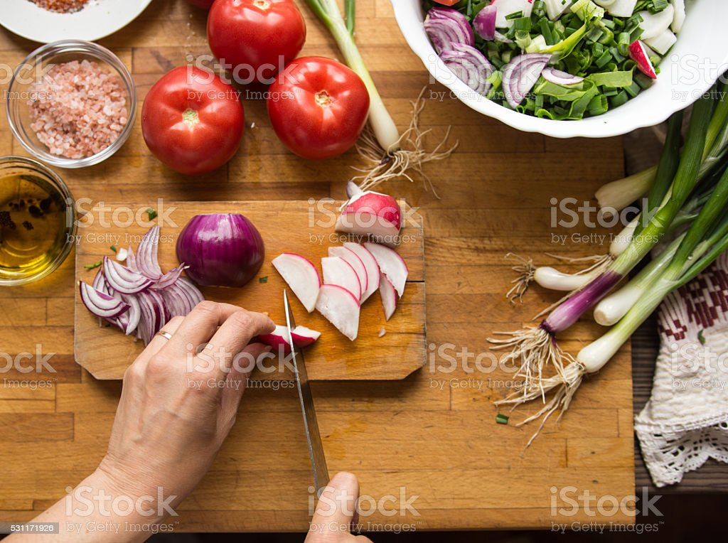 Preparing vegetables salad for lunch stock photo
