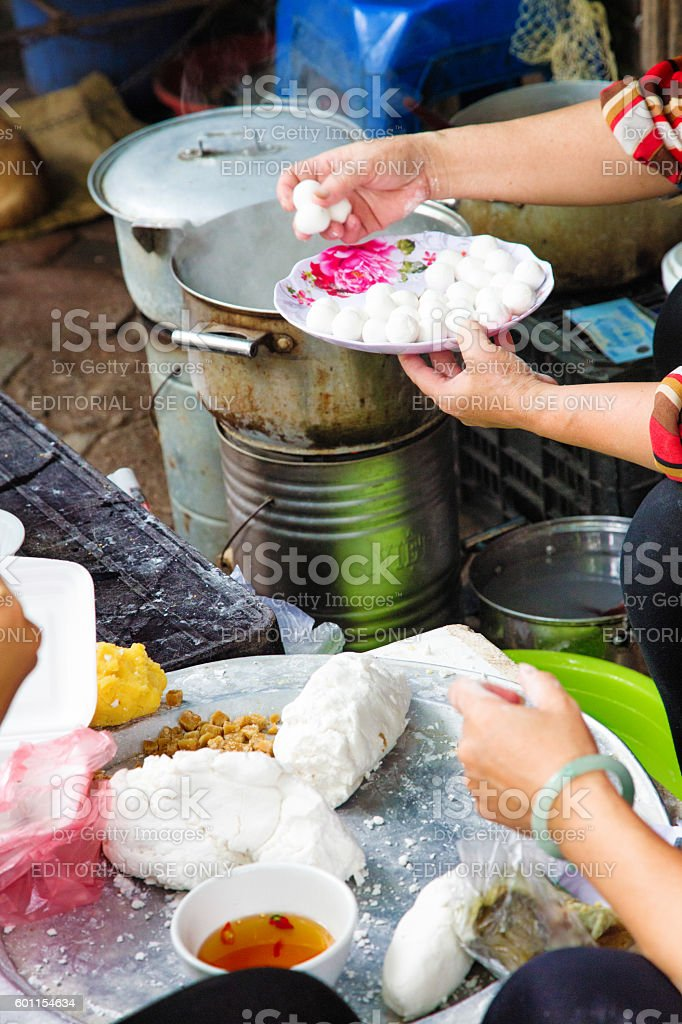 Preparing Vietnamese Banh Troi on the streets of Hanoi stock photo