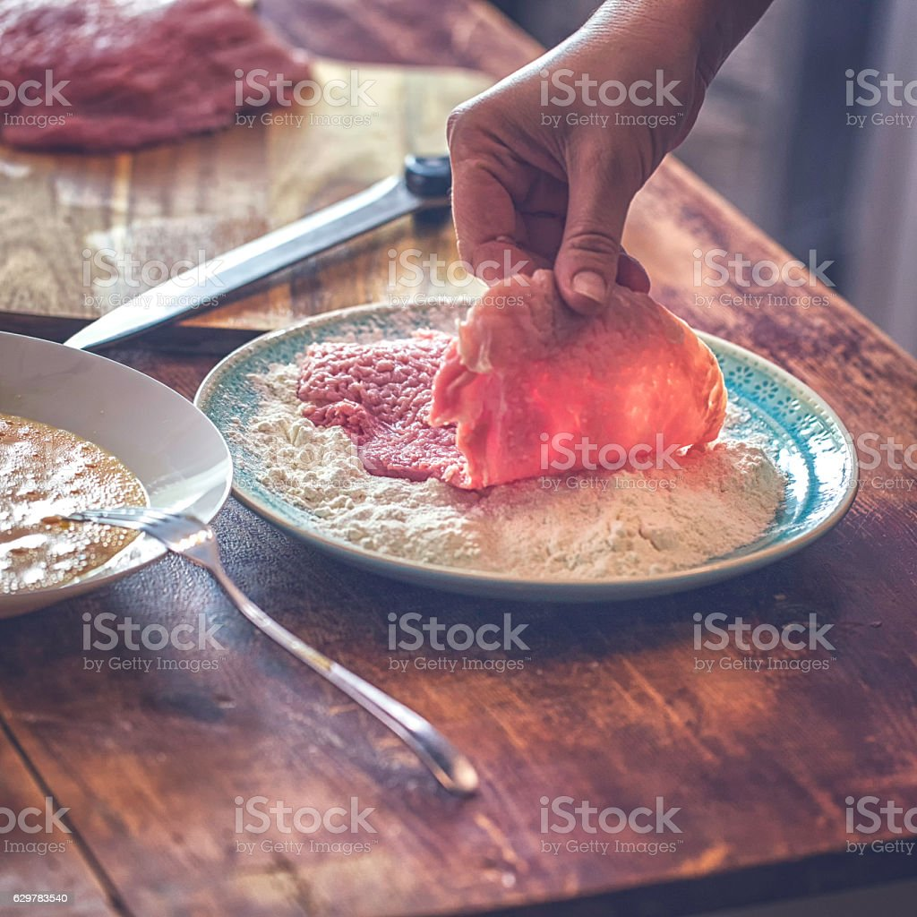 Preparing Wiener Schnitzel in Domestic Kitchen stock photo