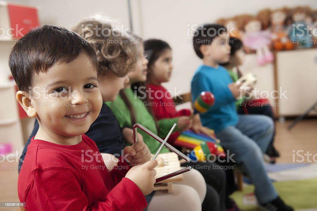 Preschool age children in music class stock photo