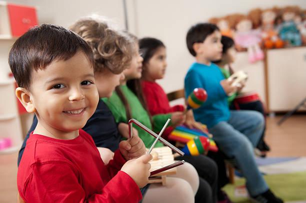 preschool age children in music class stock photo - Images Of Preschool Children