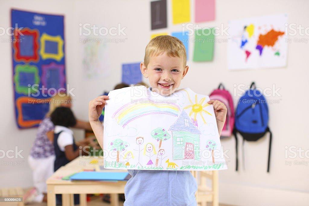 Preschool boy holding up artwork royalty-free stock photo