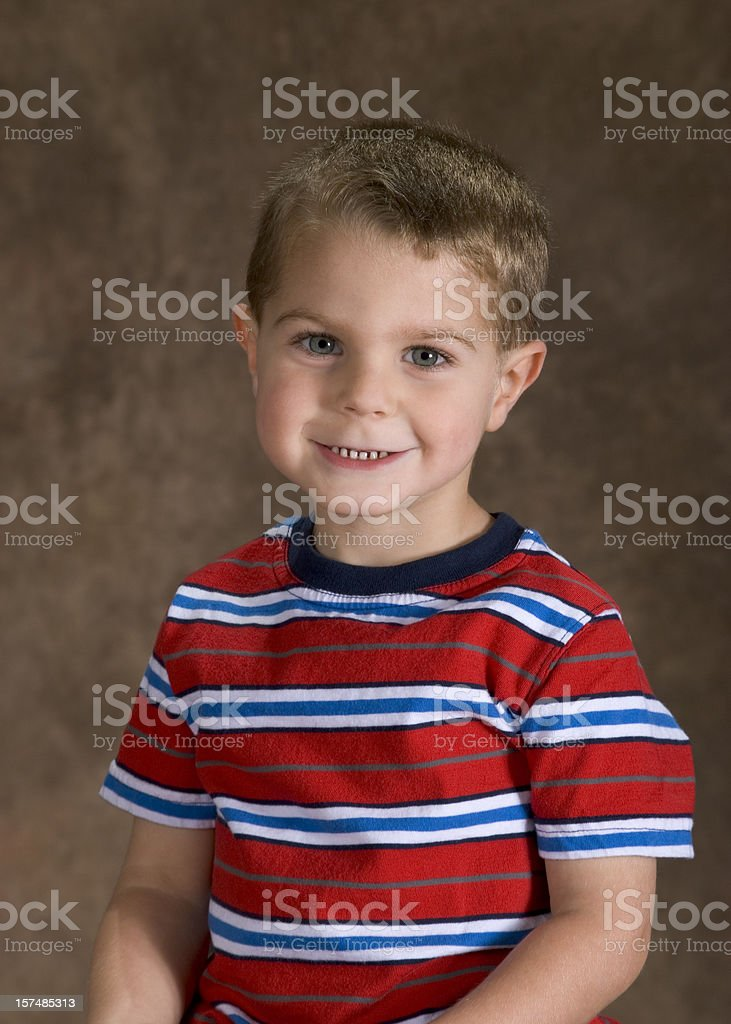 Preschool Boy Sitting For His School Picture, Cute Pose stock photo