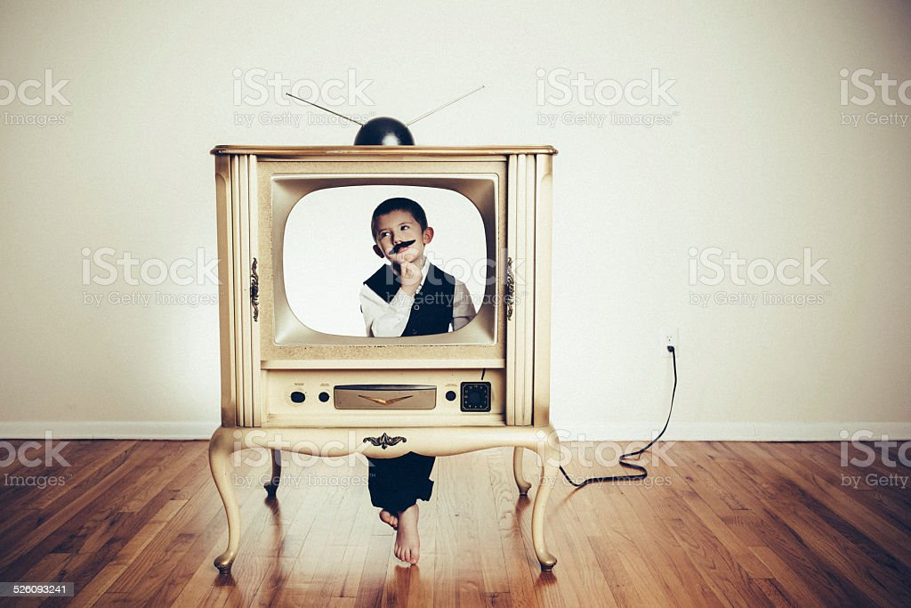 Preschool Child Playing Anchorman in Old TV stock photo