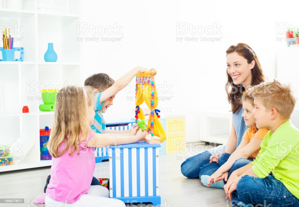 Preschool: Children Having Fun with finger puppet Show. royalty-free stock photo