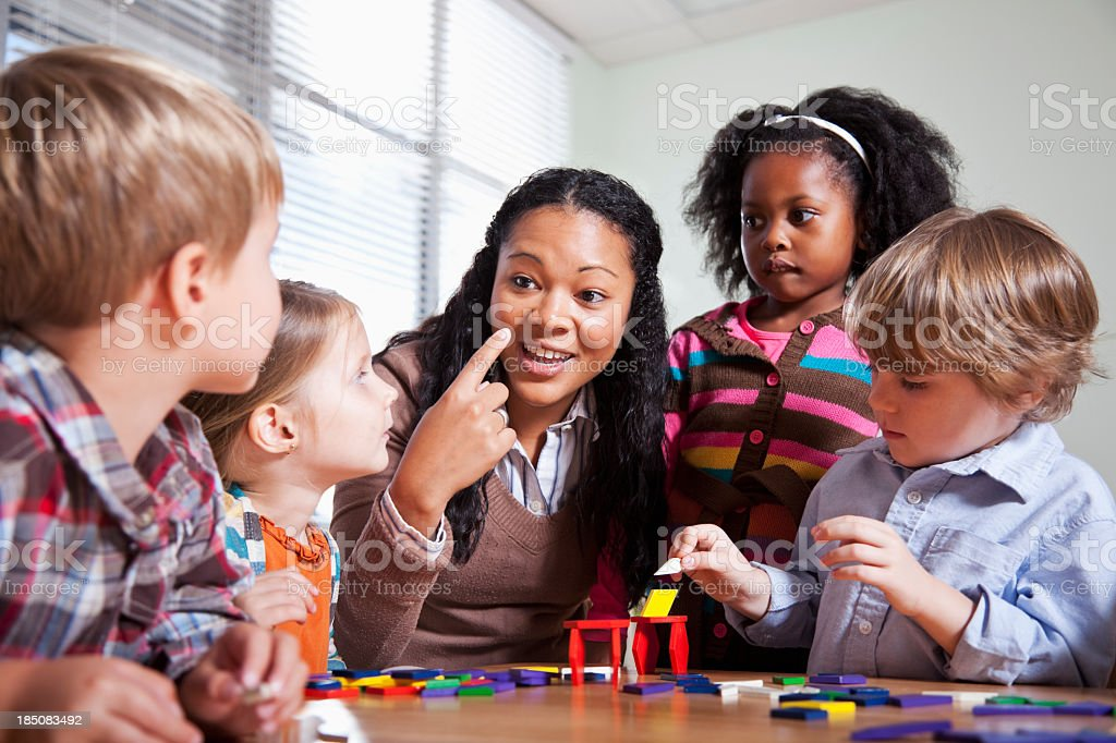Preschool children in classroom with teacher stock photo