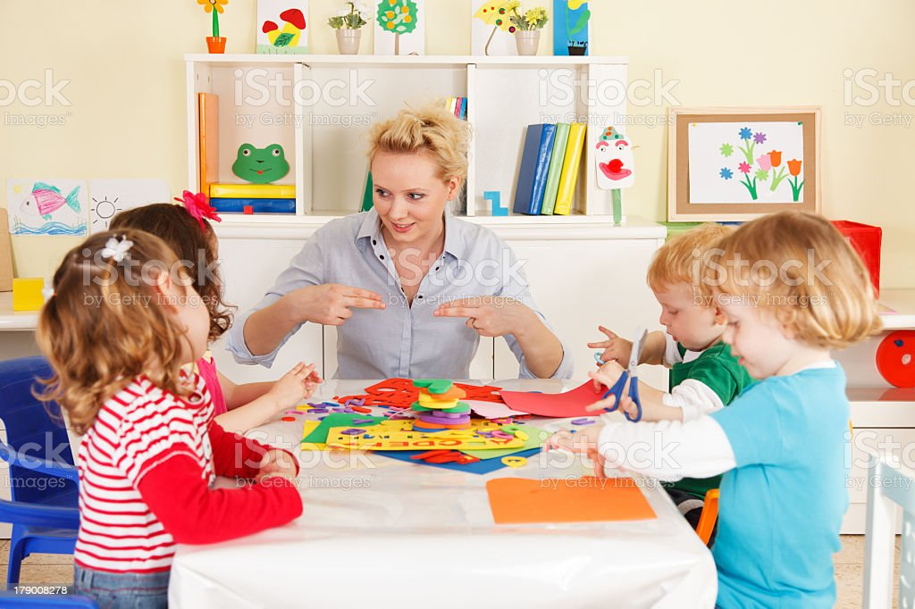 Pre-school children in the classroom with a teacher royalty-free stock photo