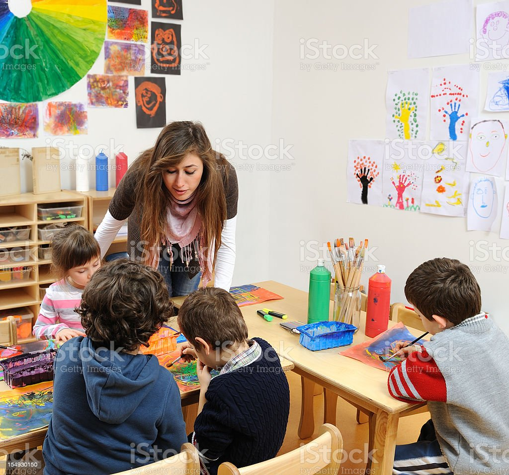 Preschool children painting in the kindergarten royalty-free stock photo