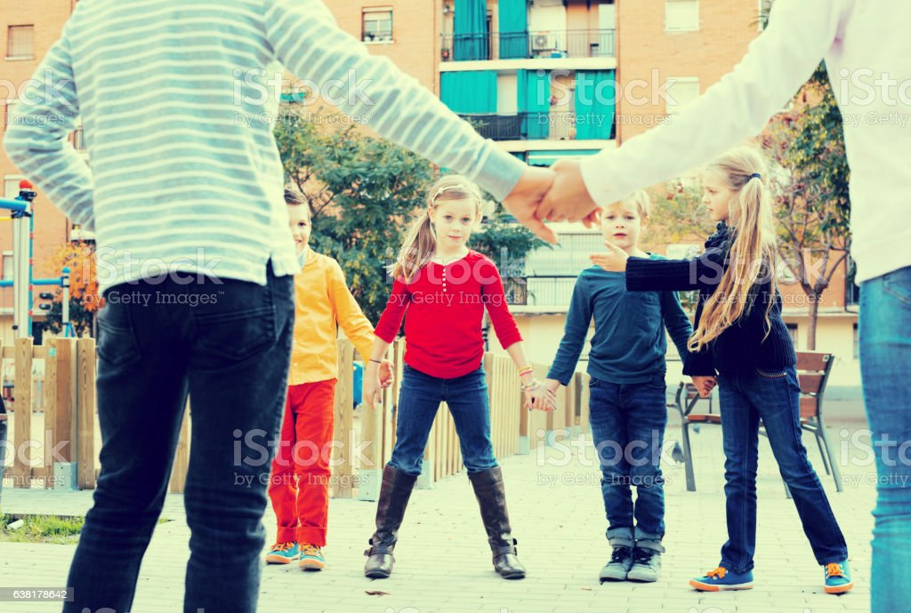 Preschool children playing forcing the city gates stock photo