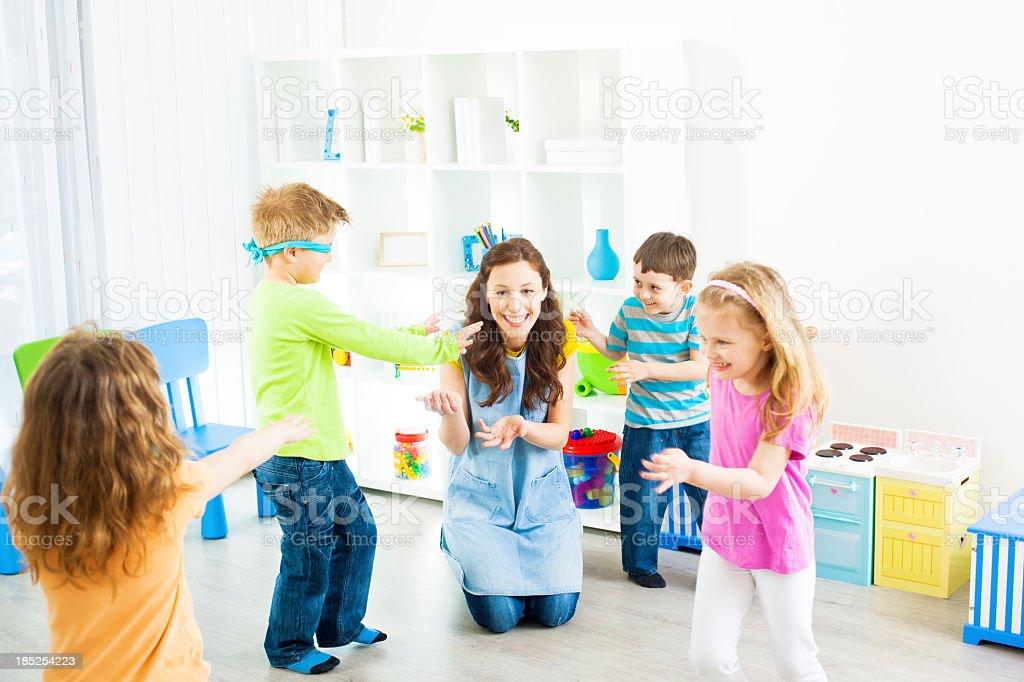 Preschool: Children Playing Hide and Seek royalty-free stock photo