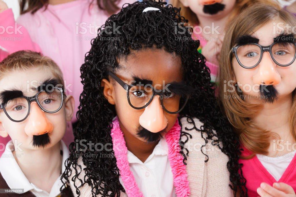 Preschool Children Wearing Disguises stock photo