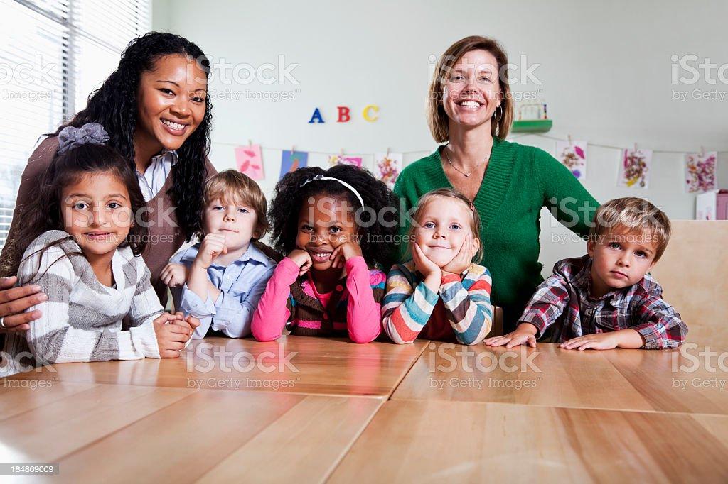 Preschool children with teachers in classroom royalty-free stock photo
