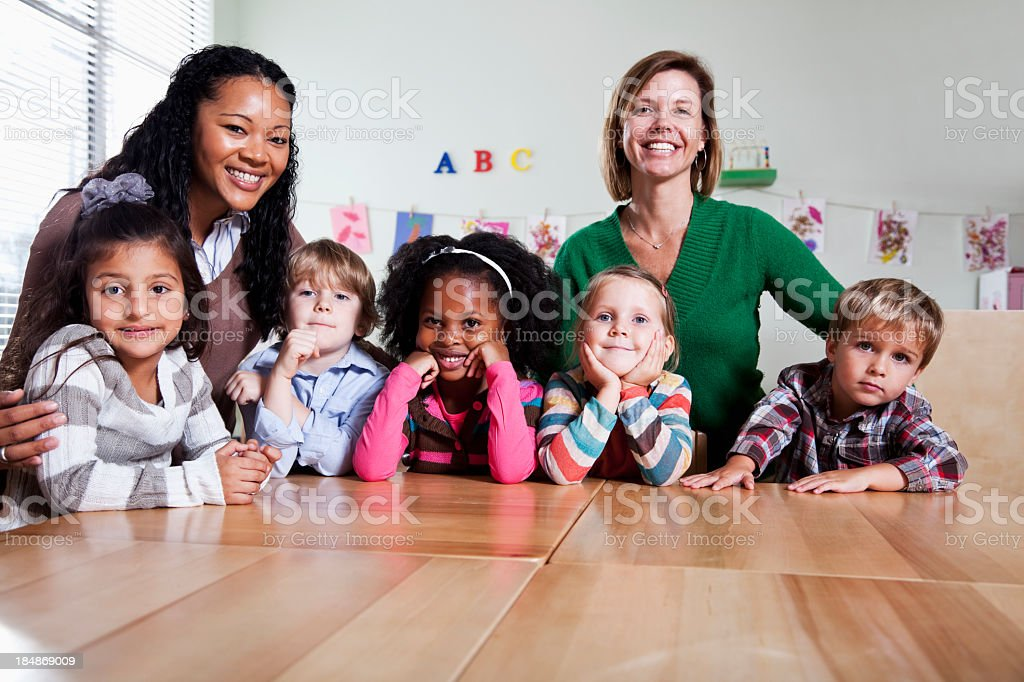 Preschool children with teachers in classroom stock photo