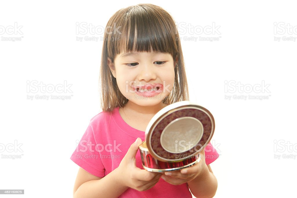 Preschool girl playing with makeup royalty-free stock photo