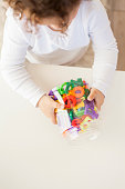 preschool girl plying with letters