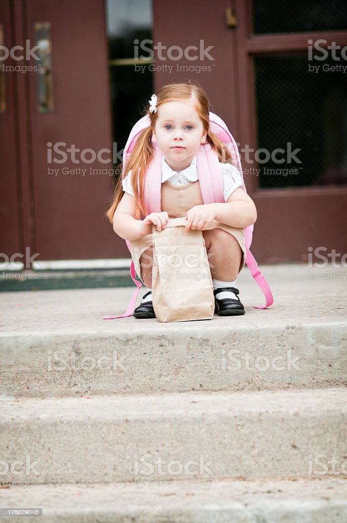 Preschool Girl Student with Lunch Bag royalty-free stock photo