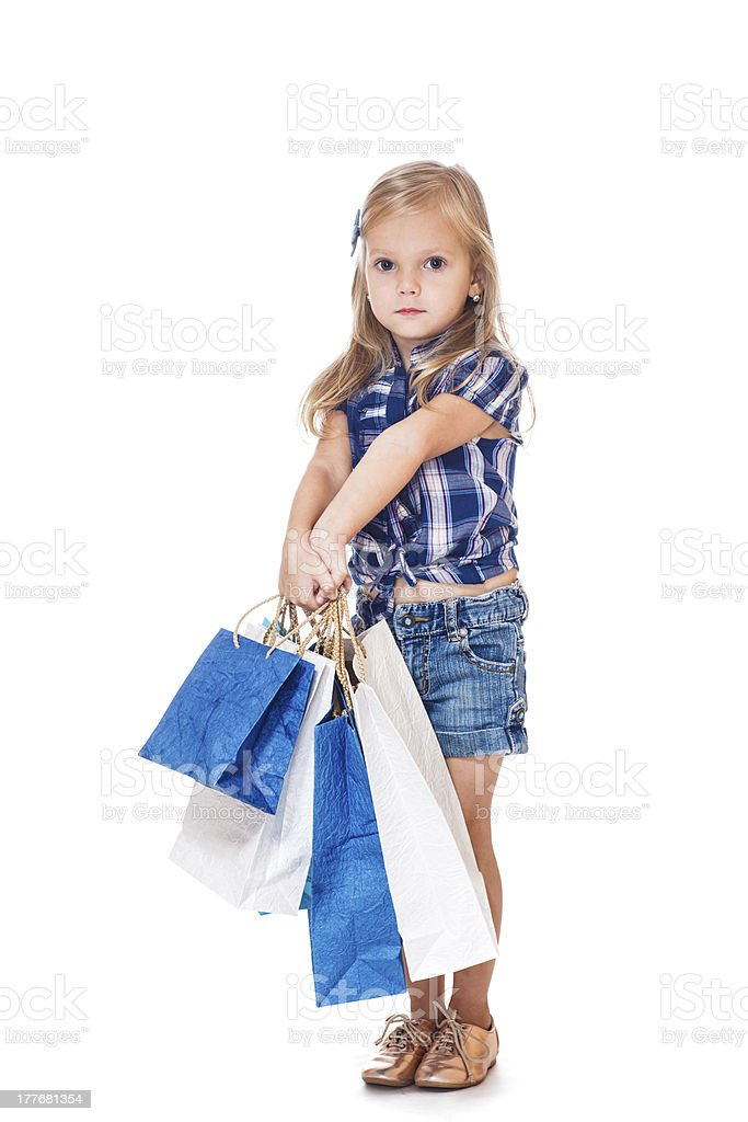 Preschool girl  with shopping bags royalty-free stock photo