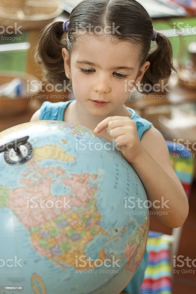 Preschool girl with world globe royalty-free stock photo