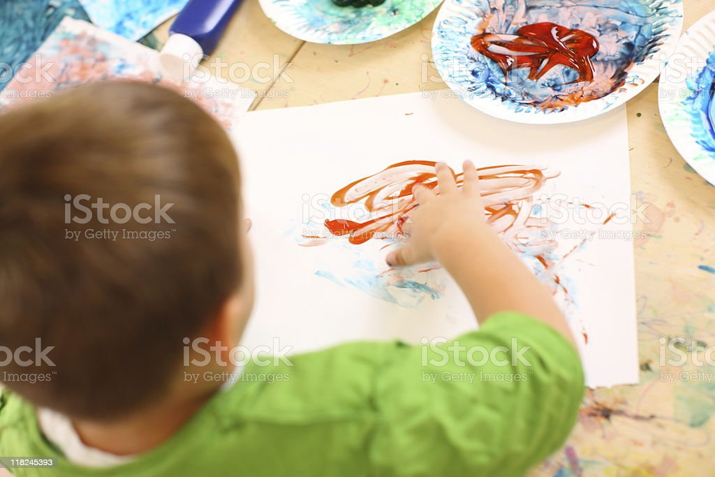 Preschool kid finger painting royalty-free stock photo