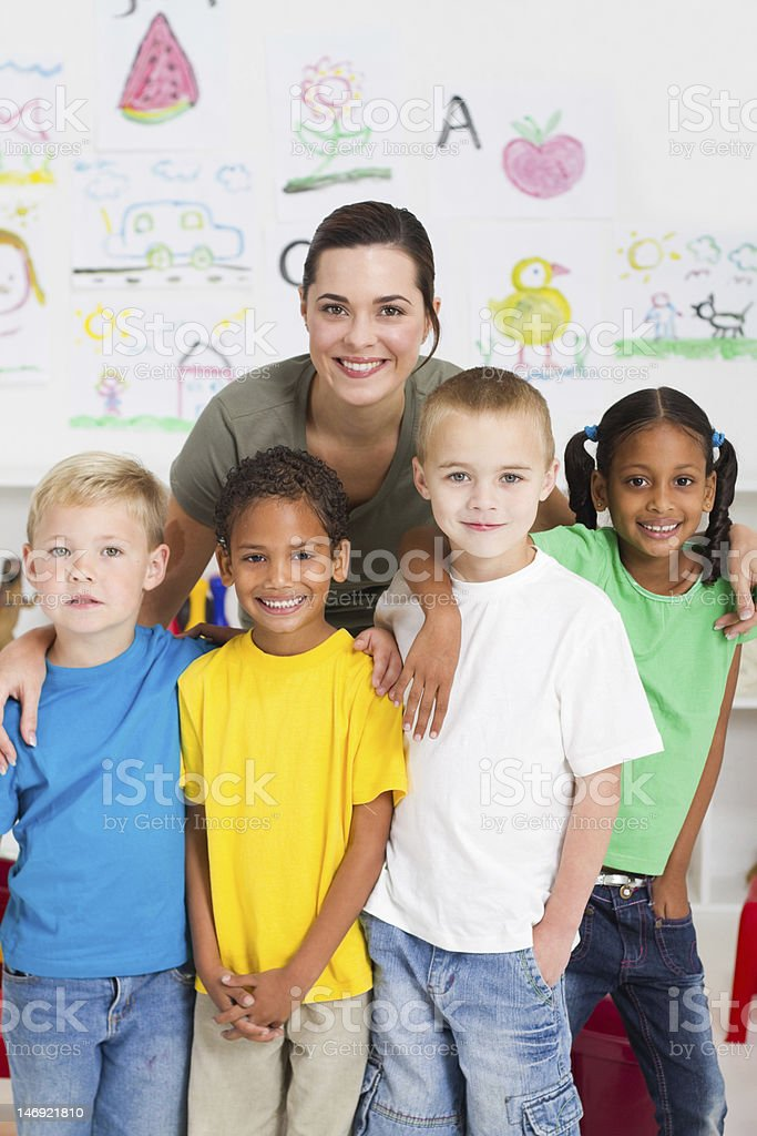 preschool kids and teacher stock photo