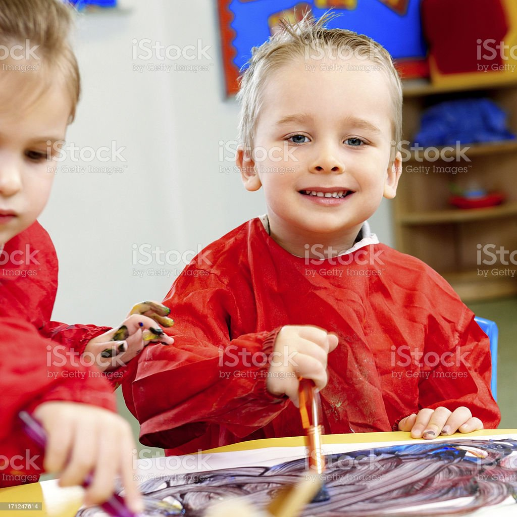 Preschool kids painting in a classroom royalty-free stock photo