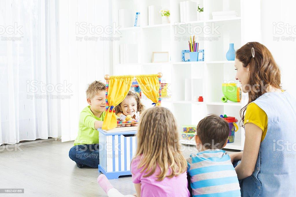 Preschool: Preschoolers Craft Activities Puppet Show. stock photo