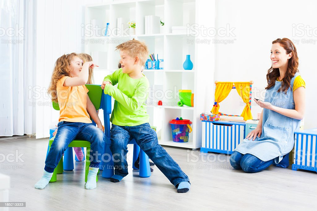 Preschool: Preschoolers Playing Musical Chairs. stock photo