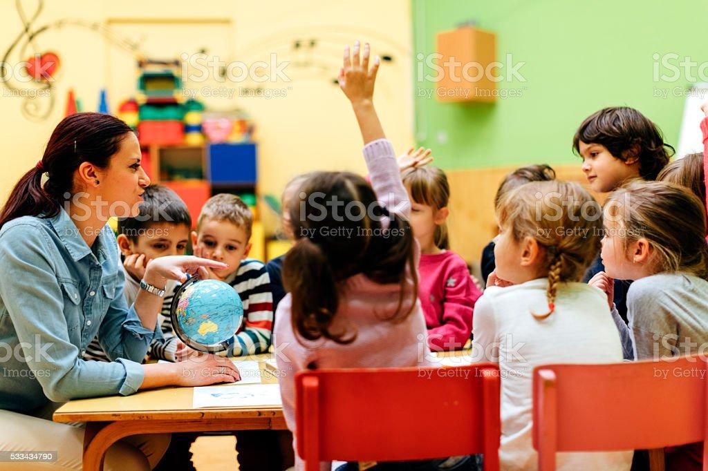 preschool teacher and children in classroom stock photo - Images Of Preschool Children