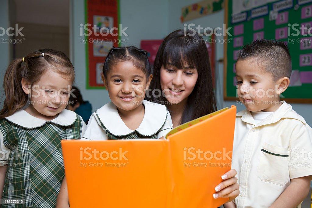 Preschool teacher and students royalty-free stock photo