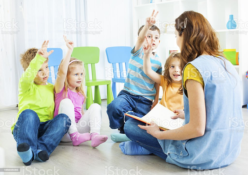 Preschool: Teacher Telling A Story to children. royalty-free stock photo