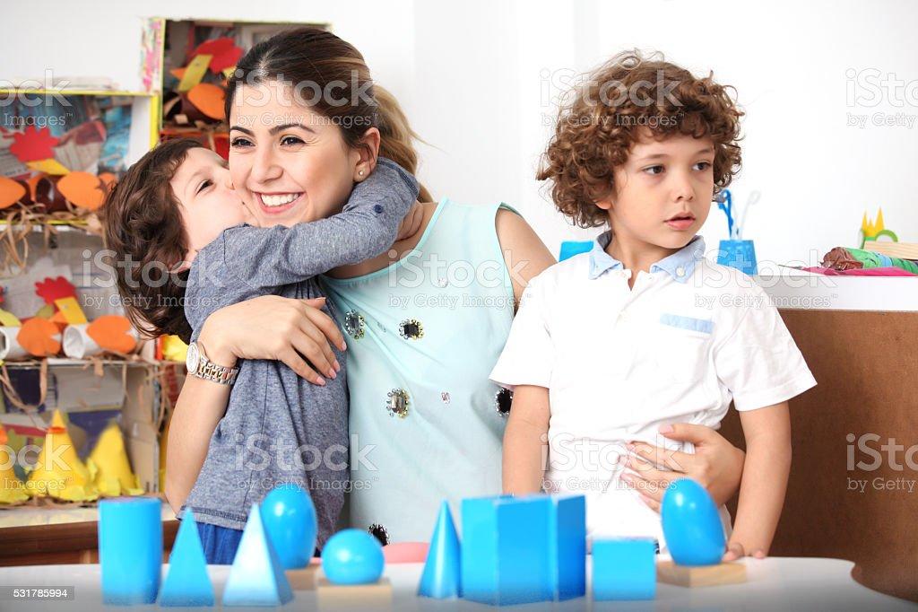 Preschool Teacher With Two Kids stock photo