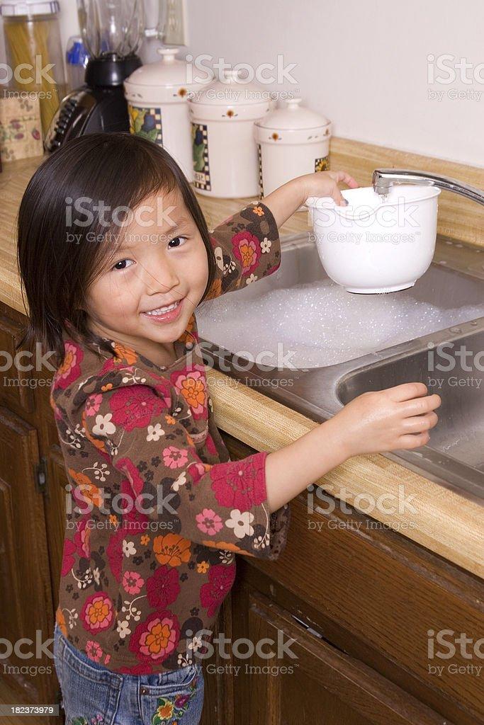 Preschooler at kitchen sink royalty-free stock photo