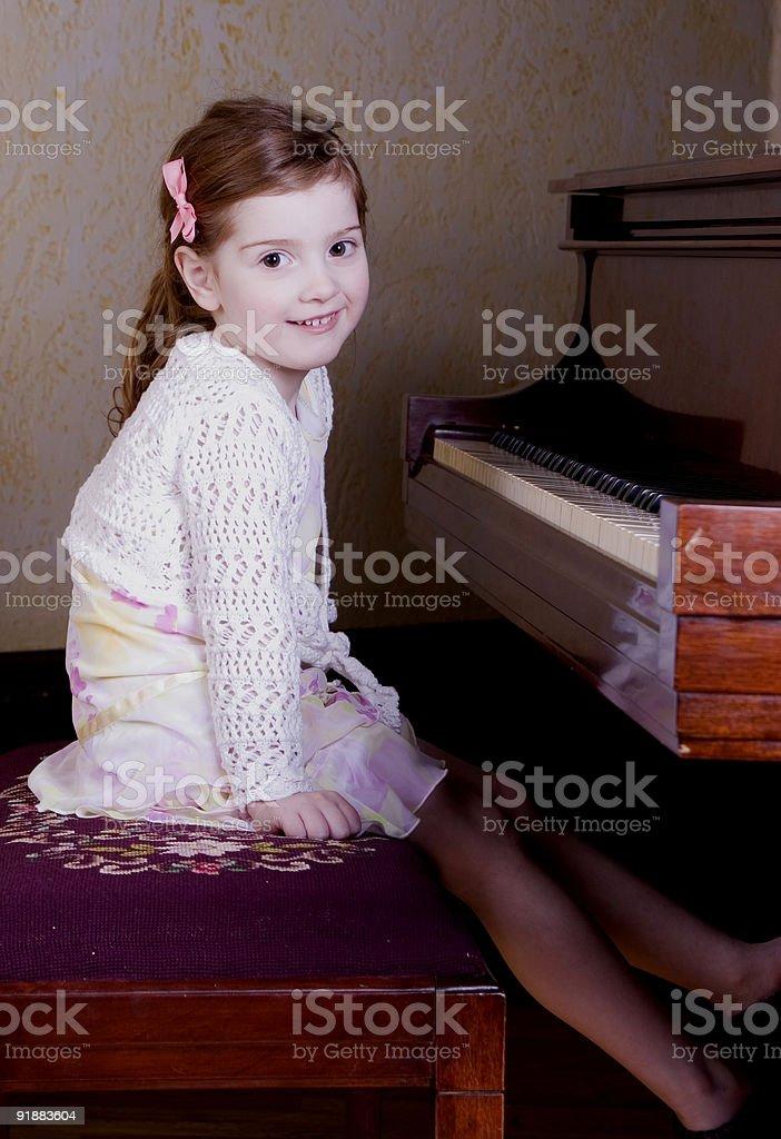 Preschooler at piano stock photo