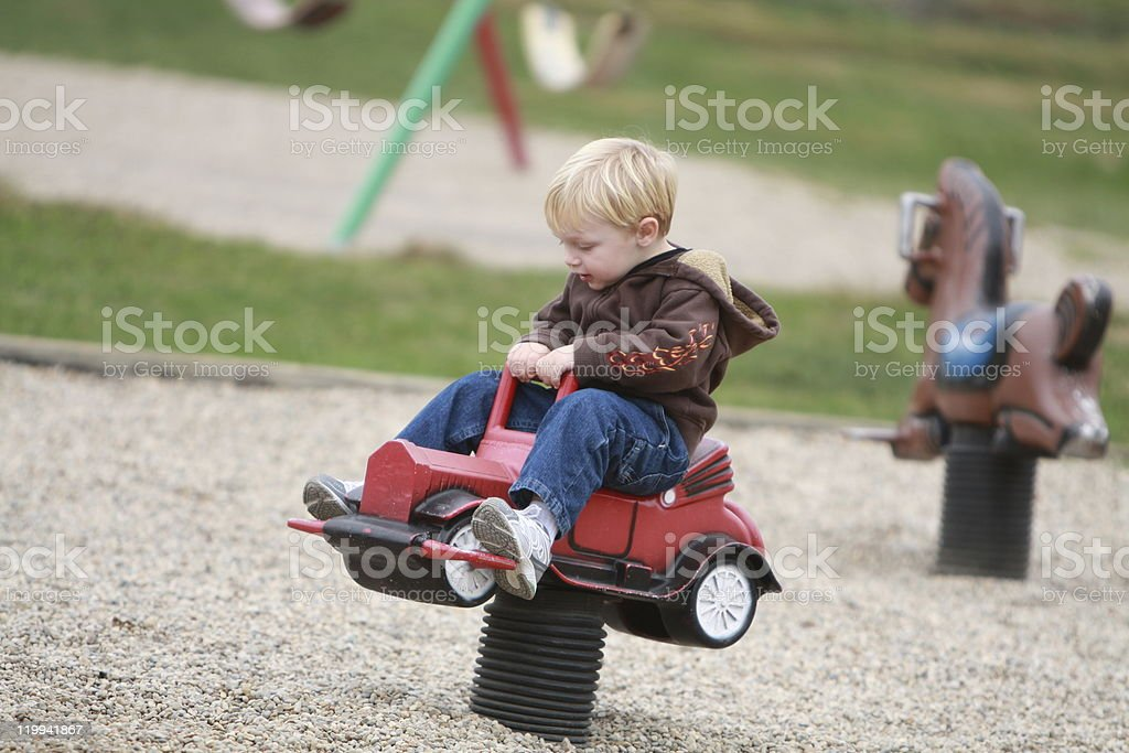 Preschooler Boy On Playground Car Spring Rider stock photo