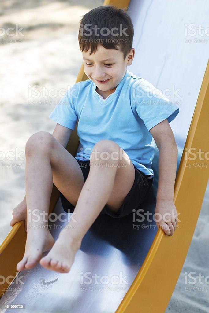 Preschooler boy on slide royalty-free stock photo