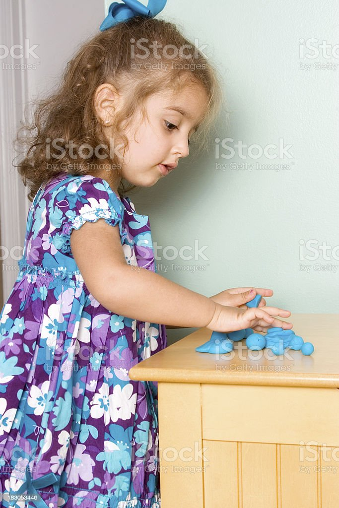 Preschooler counting the shapes she made royalty-free stock photo