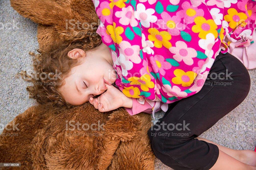 Preschooler Girl Sleeping While Sucking Her Thumb stock photo
