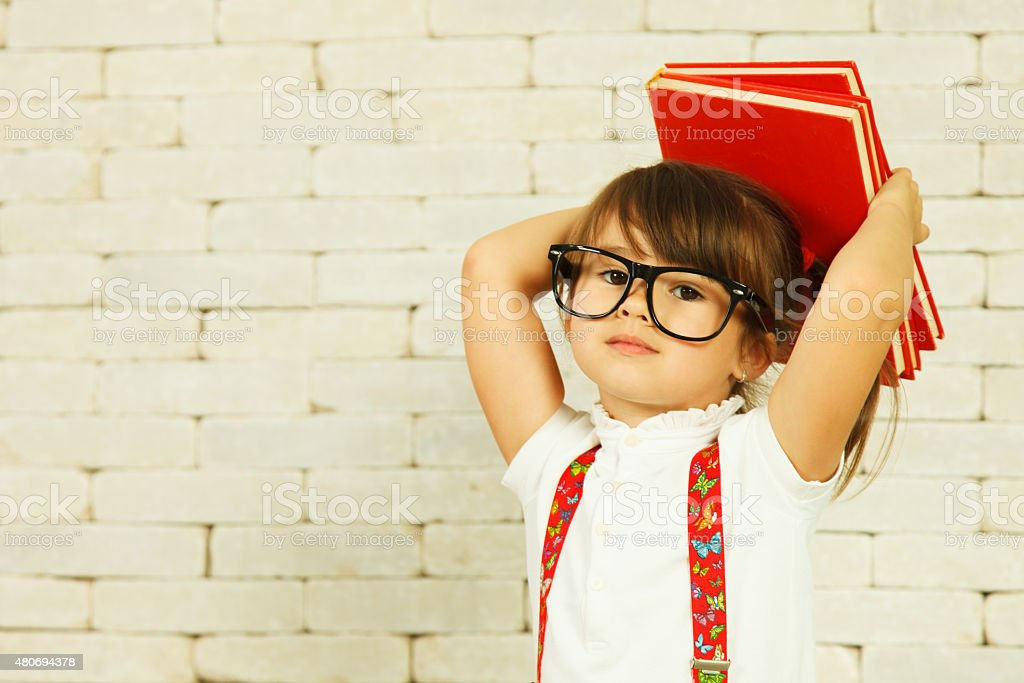 Preschooler girl with books stock photo