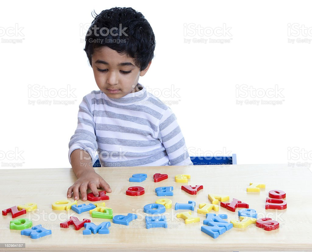 Preschooler Identifying Alphabets and Numbers, Isolated, White royalty-free stock photo