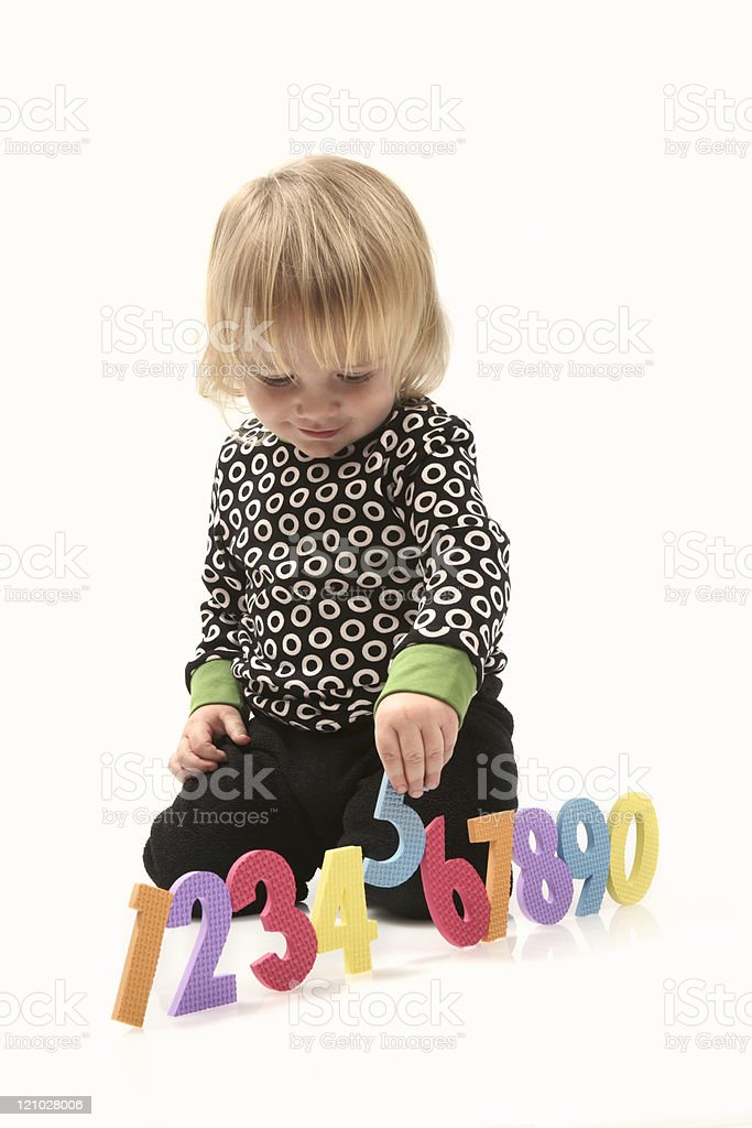 Preschooler learning numbers on white royalty-free stock photo