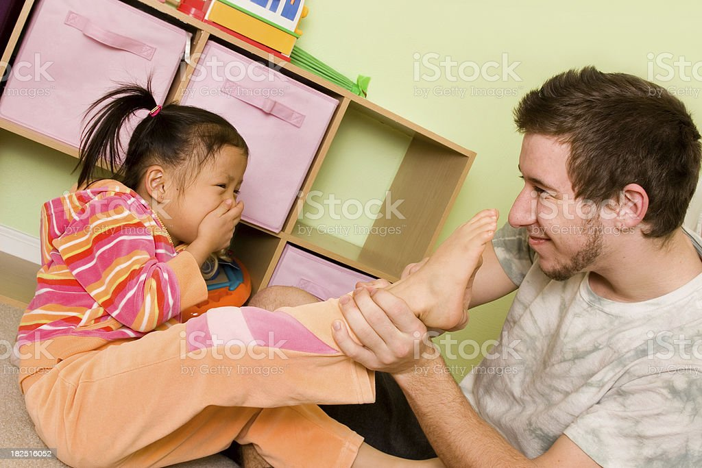 Preschooler playing with big brother royalty-free stock photo