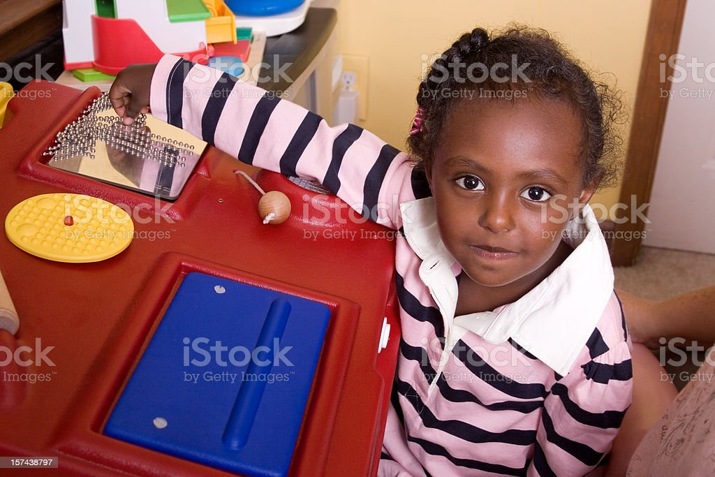 Preschooler playing with sensory activity station royalty-free stock photo