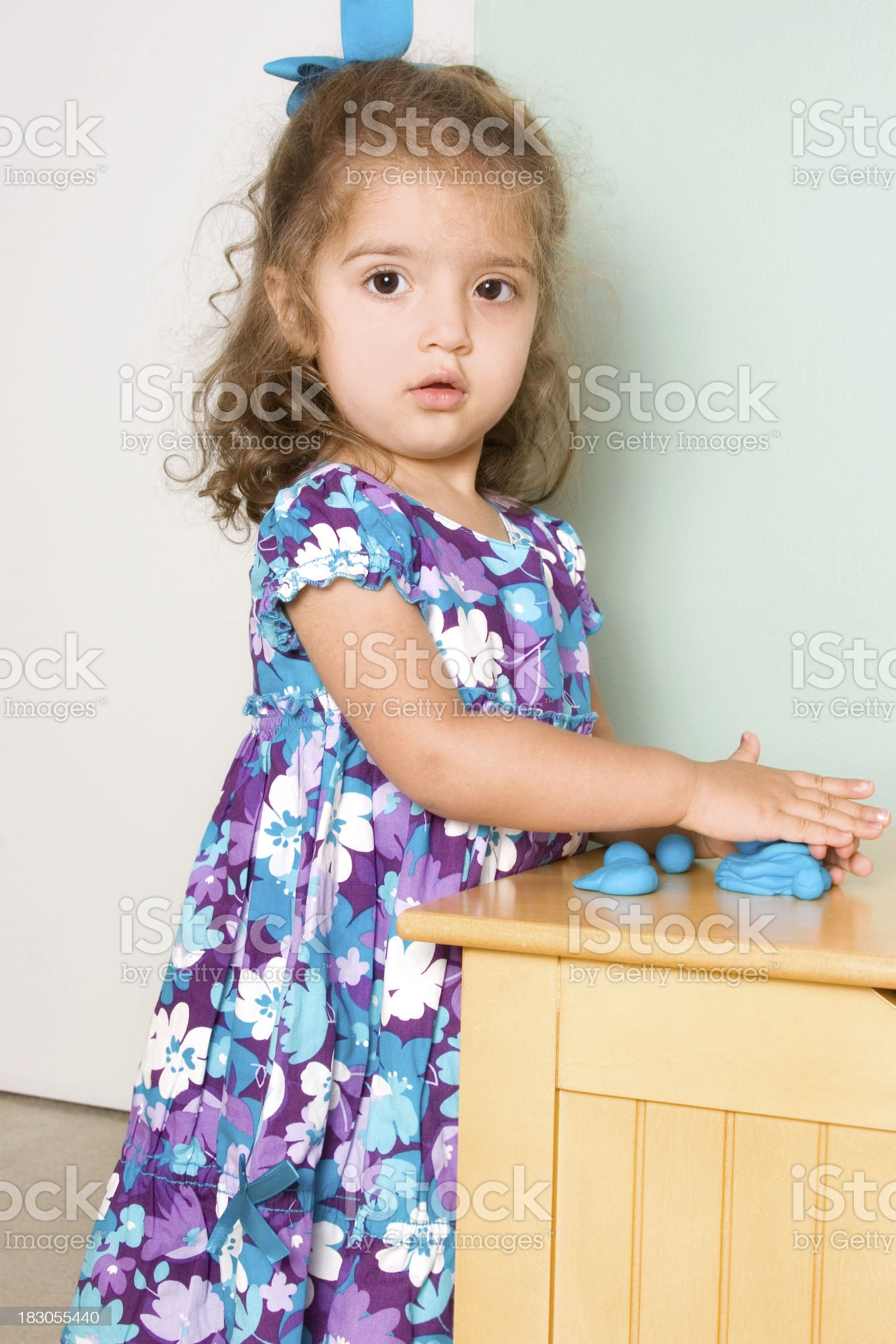 Preschooler rolling molded clay royalty-free stock photo