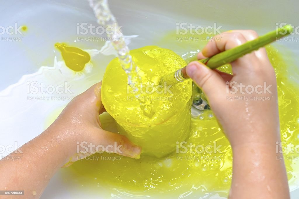 Preschooler Washing Brushes After Painting royalty-free stock photo