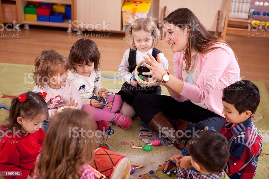 Preschoolers and Teacher stock photo