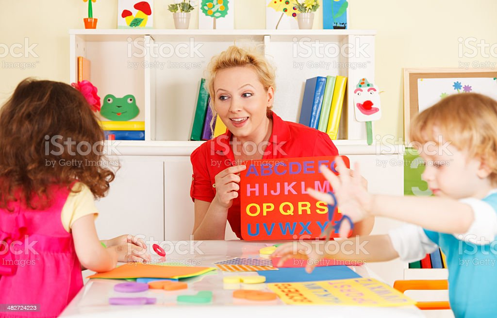 Preschoolers in the classroom with a teacher royalty-free stock photo