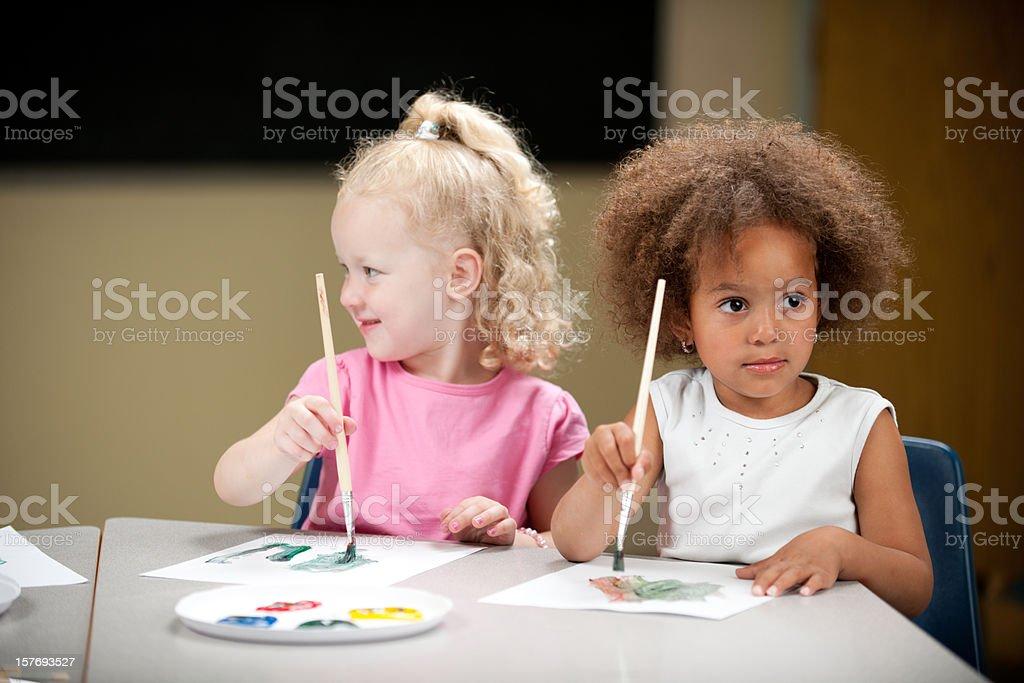 Preschoolers painting royalty-free stock photo