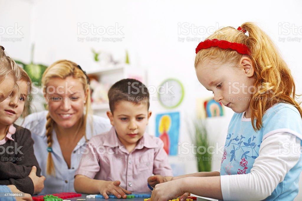 Preschoolers playing stock photo