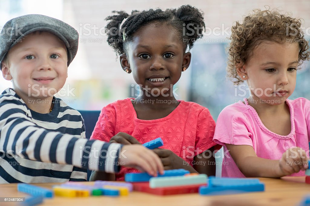 Preschoolers Playing Together in Class stock photo